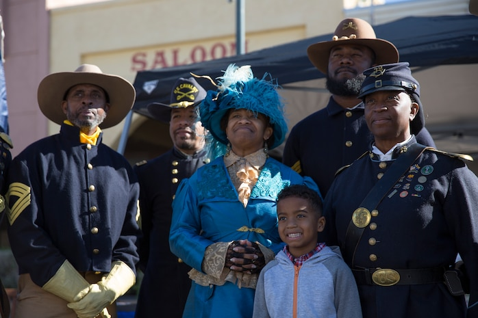 Civilians with the Buffalo Soldiers of the Arizona Territory and Ladies and Gentlemen of the Regiment pose for a group photo during Yuma Military Appreciation Day in Downtown Historic Yuma on Feb. 16, 2019. Military Appreciation Day is held to show the importance of the relationship between the City of Yuma and our service members and veterans. (U.S. Marine Corps photo by Sgt. Allison Lotz)