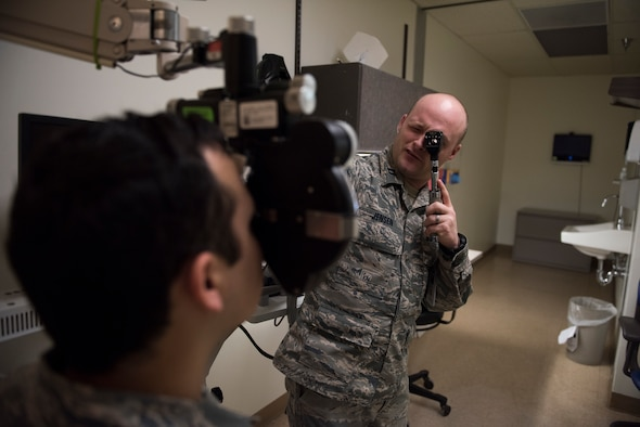 Capt. Craig Jensen, 366th Aerospace Medical Squadron optometry flight commander, performs a vision test on a patient, Feb, 25, 2019 at Mountain Home Air Force Base, Idaho. The 366th AMDS optometry clinic provides Airmen quality care all year to ensure they can see and accomplish the Air Force mission. (U.S. Air Force photo by Airman 1st Class Hailey Bivens)