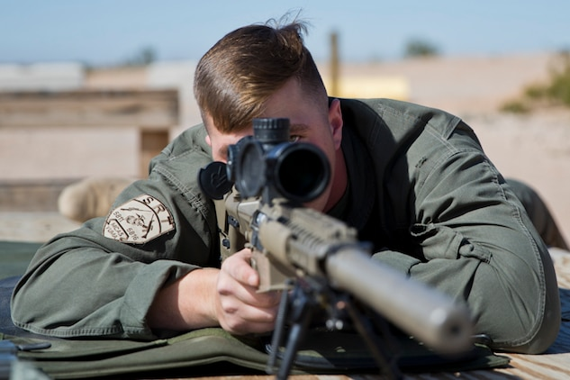 U.S. Marine Corps Cpl. Nathaniel P. Elrod a Military Police Officer with the Provost Marshal's Office (PMO), Headquarters and Headquarters Squadron (H&HS), Marine Corps Air Station (MCAS) Yuma, conducts Special reaction Team (SRT) training on range one Yuma, Ariz., Feb 27, 2019. The SRT is Comprised of military police personnel trained to give an installation commander the ability to counter or contain a special threat situation surpassing normal law enforcement capabilities. (U.S. Marine Corps photo by Lance Cpl. Joel Soriano)
