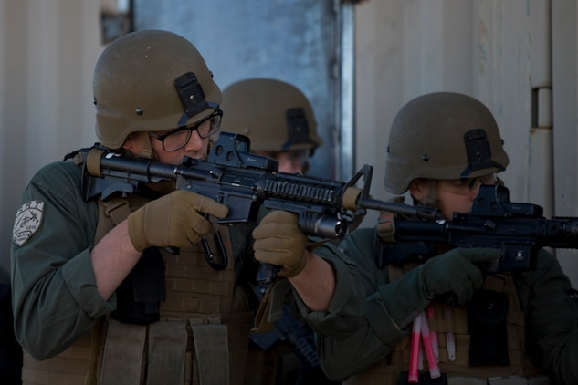 U.S. Marines with the Provost Marshal's Office (PMO), Headquarters and Headquarters Squadron (H&HS), Marine Corps Air Station (MCAS) Yuma, set up the range for Special Reaction Team (SRT) training on range one Yuma, Ariz., Feb 27, 2019. The SRT is Comprised of military police personnel trained to give an installation commander the ability to counter or contain a special threat situation surpassing normal law enforcement capabilities. (U.S. Marine Corps photo by Lance Cpl. Joel Soriano)