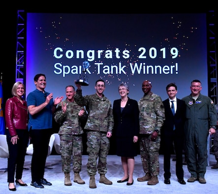The 2019 Air Force Spark Tank competition judges Secretary of the Air Force Heather Wilson, Air Force Chief of Staff Gen. David L. Goldfein and Chief Master Sgt. of the Air Force Kaleth O. Wright, Mark Cuban and George Steinbrener IV pose for a group photo with the Spark Tank winner during the Air Force Association's Air Warfare Symposium in Orlando, Florida, Feb. 28, 2019. Spark Tank is a chance to celebrate Air Force risk-takers, idea makers and entrepreneurs who refuse to accept the status quo and have determined their own fate by developing solutions that make it easier for the Air Force to bring the very best to the fight. (U.S. Air Force photo by Wayne Clark)
