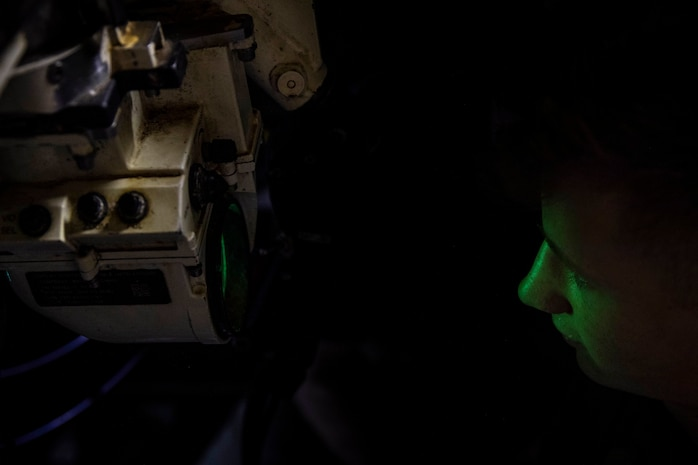 Lance Cpl. Quentin Francomano, a M88A2 Hercules recovery vehicle driver and tank mechanic with the 22nd Marine Expeditionary Unit, looks through a gun sight while conducting routine maintenance aboard the USS Kearsarge, Dec. 27, 2018. The 22nd MEU is currently on deployment to the 5th and 6th fleet areas of responsibility with the Kearsarge Amphibious Ready Group.