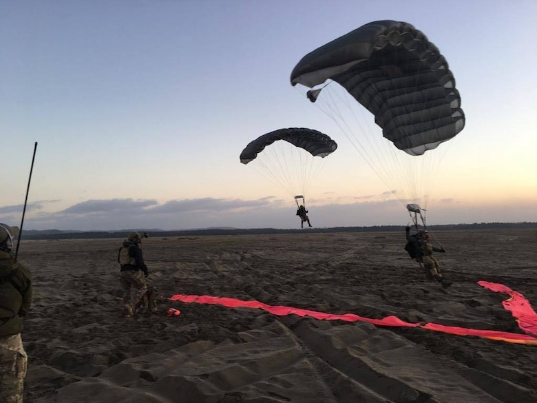 Combat controllers from the U.S. and Polish forces conduct a military free fall during a culmination exercise near Krakow on Dec. 5, 2018.