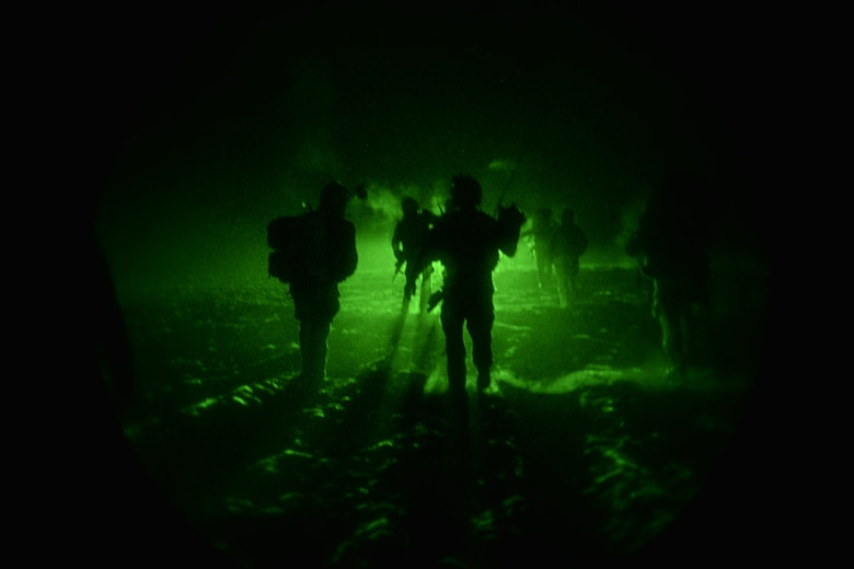 Combat controllers from the U.S. Air Force Special Operations Command's 321st Special Tactics Squadron assigned to the 352nd Special Operations Wing in England and Polish Special Operation unit simulate an airfield seizure during a culmination exercise near Krakow on Dec. 5, 2018.