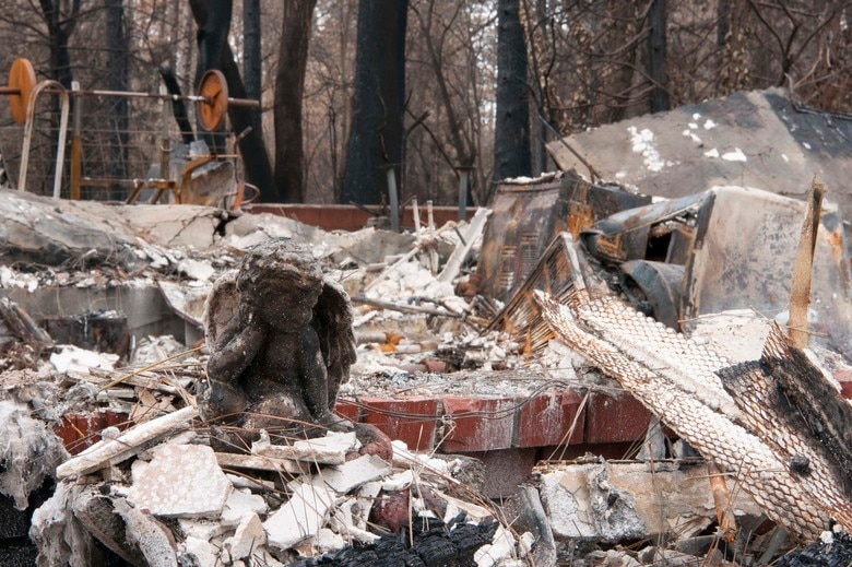 A charred guardian angel statue sits solemnly in front of what is left of the Gowins' family home in Paradise, California, Dec. 17, 2018. Their home was one of thousands consumed by the deadliest fire in California history. (U.S. Air Force photo by Staff Sgt. Taylor Workman)
