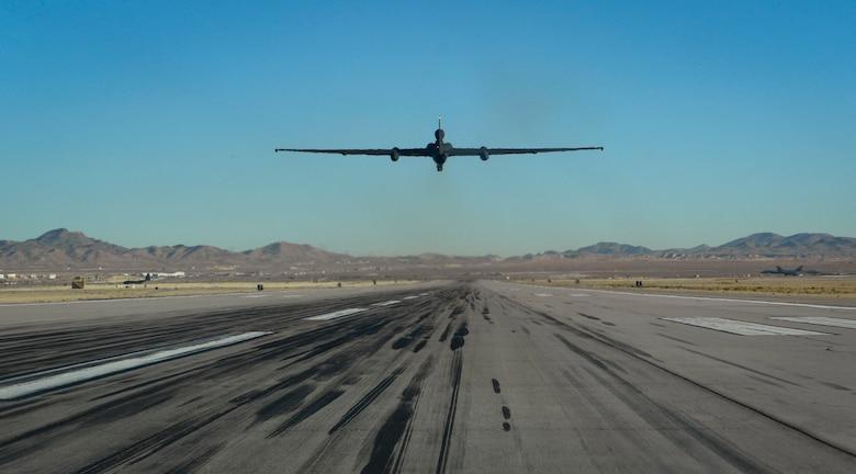 An aircraft flies straight up from the flight line.