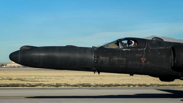 A U-2 aircraft sits on a flight line.