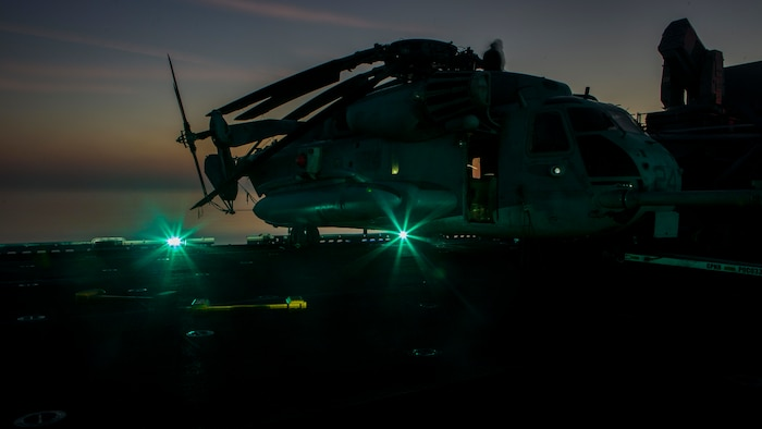 A U.S. Marine CH-53E Super Stallion with Marine Medium Tiltrotor Squadron 166 Reinforced, 13th Marine Expeditionary Unit, is staged aboard the Wasp-class amphibious assault ship USS Essex, Dec. 30, 2018. The Essex is the flagship for the Essex Amphibious Ready Group and, with the embarked 13th MEU, is deployed to the U.S. 5th Fleet area of operations in support of naval operations to ensure maritime stability and security in the Central Region, connecting the Mediterranean and the Pacific through the western Indian Ocean and three strategic choke points.