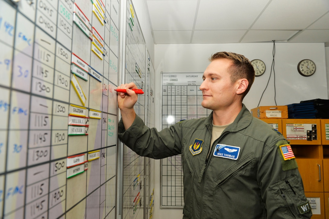 U.S. Air Force Capt. Mike Thomas, 37th Airlift Squadron central scheduler, reviews his unit's flight schedule on Ramstein Air Base, Germany, Dec. 19, 2018. The 37th AS always has a team on standby to respond to missions any time of the year. (U.S. Air Force photo by Senior Airman Joshua Magbanua)