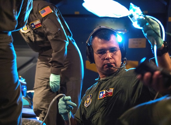 Tech. Sgt. Edgar Ramirez, 433rd Aeromedical Evacuation Squadron medical technician from Joint Base San Antonio-Lackland, participates in a training scenario during a C-5M Super Galaxy AE proof of concept flight from Scott Air Force Base, Illinois, Dec. 6, 2018. Active duty, Reserve and Delaware Air National Guard Airmen worked together during the PoC flight to test the cargo compartment of the C-5M with the goal of establishing the aircraft as part of the universal qualification training program for all AE crews. If approved and certified, the C-5M will have the capability to move three times the current capacity in one mission compared to other AE platforms.