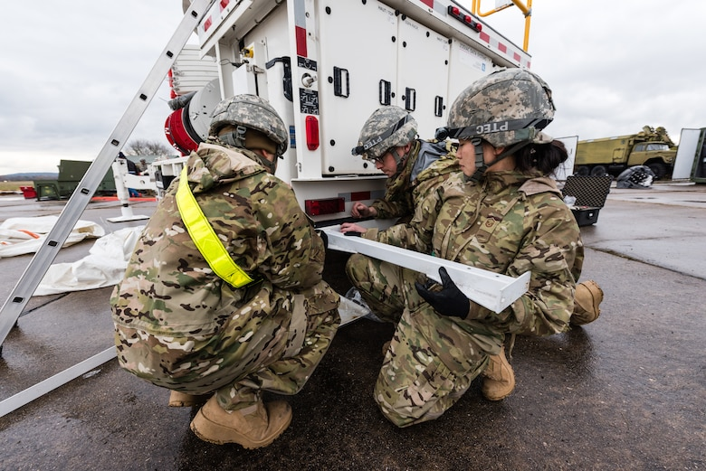 U.S. Air Force Airmen from the 24th Intelligence Squadron Eagle Vision 1 team set up an antenna for exercise Contested Forge '18 at Grostenquin Air Base, France, Dec. 4, 2018. EV 1 is the Department of Defense's only active duty commercial satellite imagery downlink system; its location in Europe enables it to support both NATO and U.S. Air Force missions in Europe. (U.S. Air Force photo by Senior Airman Lauren Parsons)