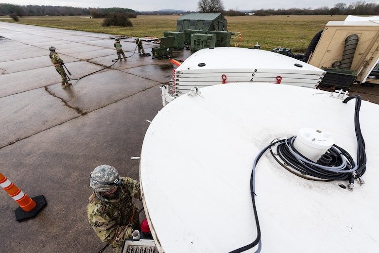 U.S. Air Force Airmen from the 24th Intelligence Squadron Eagle Vision 1 team set up an antenna for exercise Contested Forge '18 at Grostenquin Air Base, France, Dec. 4, 2018. The EV 1 system consists of two main elements: a Data Acquisition Segment, which collects and processes imagery, and a Data Integration Segment, which processes images into products for commanders. (U.S. Air Force photo by Senior Airman Lauren Parsons)