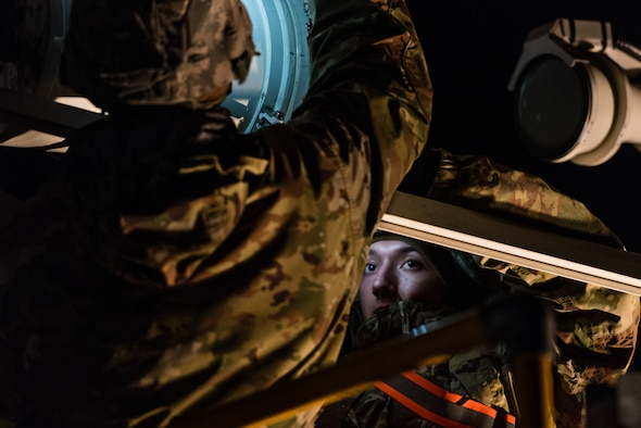 U.S. Air Force Airman 1st Class Nicolas, 24th Intelligence Squadron Eagle Vision 1 Data Acquisition Segment operator, assists with setting up an antenna for exercise Contested Forge '18 at Grostenquin Air Base, France, Dec. 4, 2018. The weeklong exercise ensured the EV 1 team could meet rapid mobility requirements. (U.S. Air Force photo by Senior Airman Lauren Parsons)