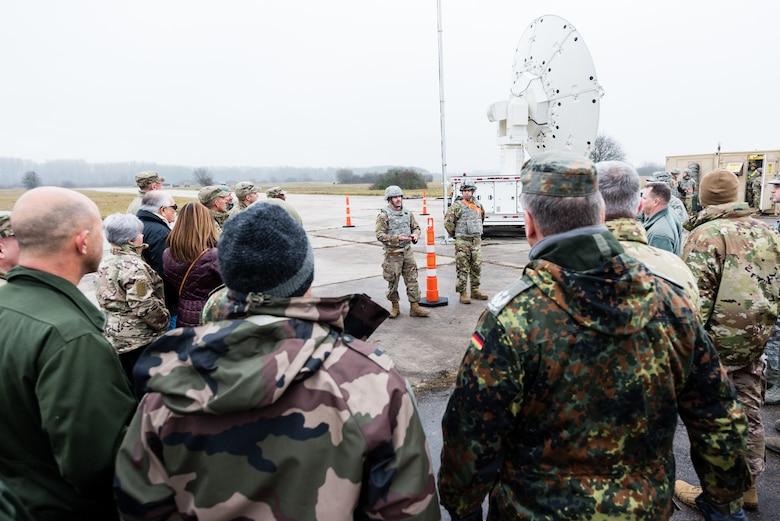 U.S. Air Force Airmen with the 24th Intelligence Squadron Eagle Vision 1 flight greet distinguished visitors during exercise Contested Forge '18 at Grostenquin Air Base, France, Dec. 5, 2018. EV 1, based out of Ramstein Air Base, Germany, is one of five EV units across the Air Force; the others belong to the Air National Guard in South Carolina, Alabama, California and Hawaii. (U.S. Air Force photo by Senior Airman Lauren Parsons)