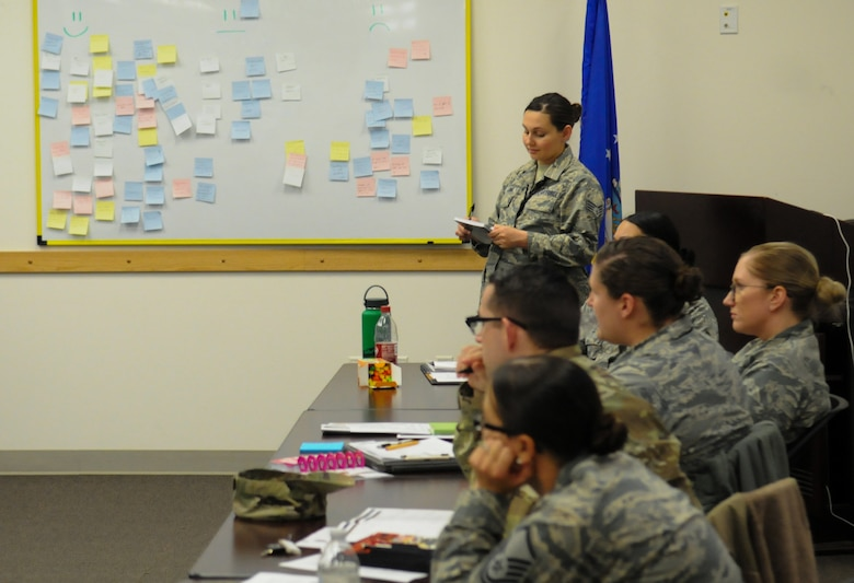 U.S. Air Force Staff Sgt. Krista Luna, 548th Intelligence, Surveillance and Reconnaissance Group Kessel Run program manager, reads notes during the first Combat Readiness Sustainment Program conference at Beale Air Force Base, California, Dec. 13, 2018. More than 20 Airmen attended the conference and participated in exercises to help improve CRSP sites. (U.S. Air Force photo by Airman 1st Class Michael Richmond)