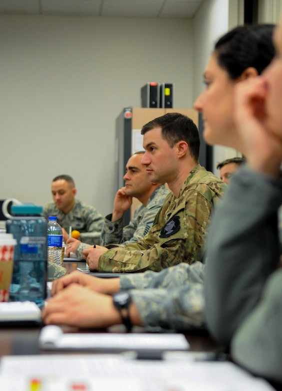 U.S. Air Force Staff Sgt. Ulrick Swigart, 45th Intelligence Squadron geospatial intelligence analyst, listens to speakers discuss Combat Readiness Sustainment Programs changes during a conference at Beale Air Force Base, California, Dec. 12, 2018. The CRSP removes Airmen from deployed-in-place environments to help them learn about resiliency. (U.S. Air Force photo by Airman 1st Class Michael Richmond)