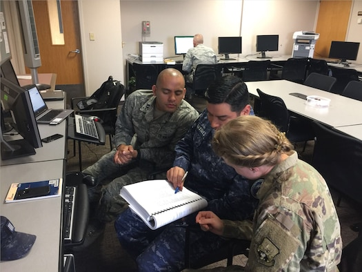 LEAP scholars work with El Salvadoran Inter-American Air Forces Academy (IAAFA) instructor