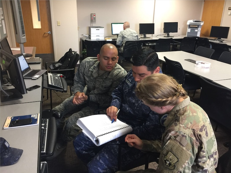 LEAP scholars work with El Salvadoran Inter-American Air Forces Academy (IAAFA) instructor