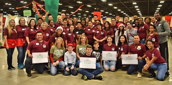 Reserve Citizen Airmen of the 433rd Aerospace Medicine Squadron at Joint Base San Antonio-Lackland, along with family and friends, pose for photo after serving meals at 