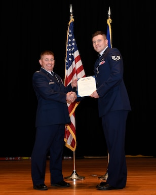 MALMSTROM AIR FORCE BASE, Mont. -- Col. Rusty Vaira, 219th RED HORSE Squadron commander, left, presents Staff Sgt. Damian Guzman with an Air Force Achievement Medal during a ceremony Dec. 2, 2018.