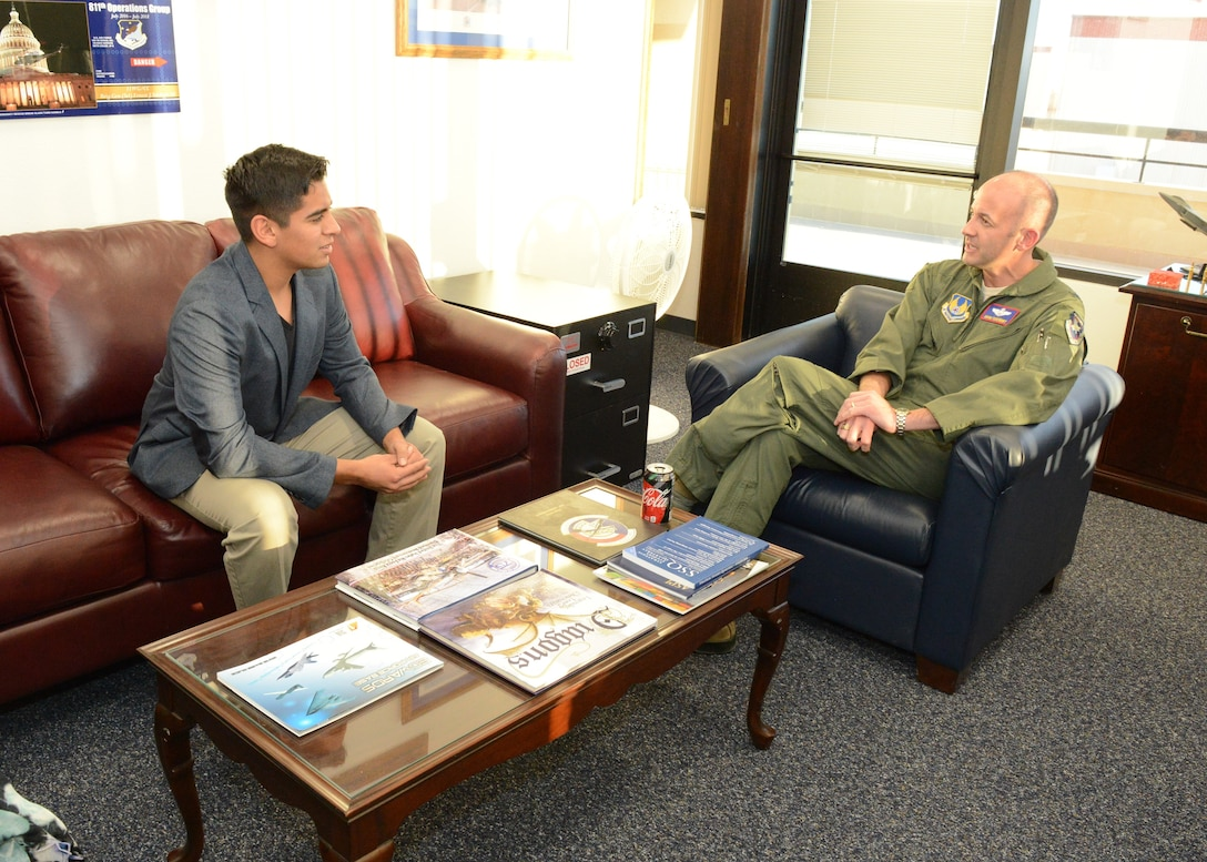 Lancaster High School student Enrique Arjona sits down for a talk with Brig. Gen. E. John Teichert, 412th Test Wing commander, at 412th TW Headquarters Jan. 2. Arjona was congratulated on his acceptance to the U.S. Air Force Academy. (U.S. Air Force photo by Kenji Thuloweit)