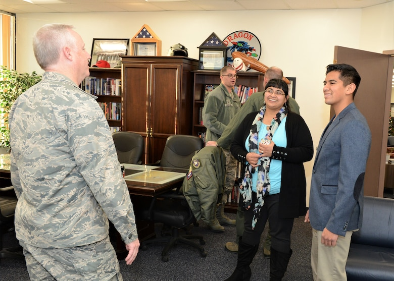 Lancaster High School student Enrique Arjona (right) and his mother, Monica Mancera, talks with Col. Kirk Reagan, 412th Test Wing vice commander, at 412th TW Headquarters Jan. 2. Arjona was congratulated on his acceptance to the U.S. Air Force Academy. (U.S. Air Force photo by Kenji Thuloweit)