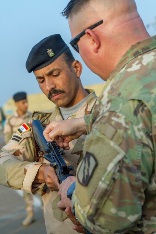 U.S. Army Sgt. 1st Class Michael Garner, right, security forces platoon sergeant assigned to Task Force India Bravo, teaches an Iraqi Army primary marksmanship instruction course at Camp Taji, Iraq, Dec.19, 2018.  Task Force India Bravo is comprised of Soldiers from 1st Squadron, 98th Cavalry Regiment, 106th Support Battalion and 2nd Battalion, 114th Field Artillery Regiment, 155th Armored Brigade Combat Team, Mississippi Army National Guard, and is deployed in support of Combined Joint Task Force – Operation Inherent Resolve, working with the Iraqi Security Forces to develop a sustainable and inclusive force that can secure its sovereign borders, protect the population, and ensure the lasting defeat of ISIS.