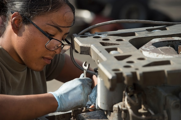 Airman 1st Class Annaliz Rodriguez, 379th Expeditionary Maintenance Squadron aerospace ground equipment (AGE) journeyman, fixes a leak found during routine maintenance for a bomb lift Jan. 4, 2018, at Al Udeid Air Base, Qatar. AGE Airmen here perform maintenance on a variety of aircraft equipment including bomb lifts, hydraulic test stands, air conditioners, heaters and power carts. (U.S. Air Force photo by Tech. Sgt. Christopher Hubenthal)