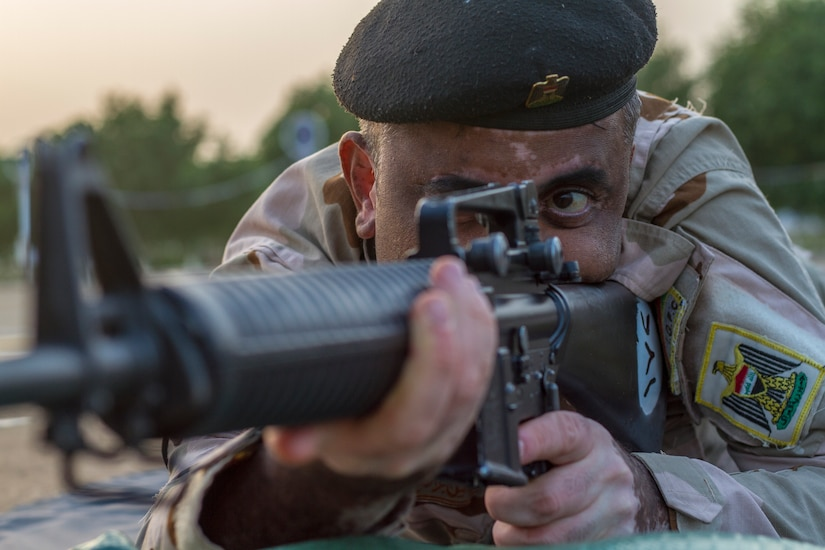 An Iraqi soldier conducts a dime/washer drill as part of a primary marksmanship instruction course held at Camp Taji, Iraq, Dec.19, 2018. The course is taught by Task Force India Bravo, a unit comprised of Soldiers from 1st Squadron, 98th Cavalry Regiment, 106th Support Battalion and 2nd Battalion, 114th Field Artillery Regiment, 155th Armored Brigade Combat Team, Mississippi Army National Guard, and is tasked with training the Iraqi 9th Armor Division. This Task Force is deployed in support of Combined Joint Task Force – Operation Inherent Resolve, working with the Iraqi Security Forces to develop a sustainable and inclusive force that can secure its sovereign borders, protect the population, and ensure the lasting defeat of ISIS.