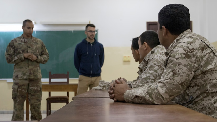 U.S. Army Staff Sgt. Francisco Vega, the materiel readiness noncommissioned officer for the 300th Sustainment Brigade, speaks to soldiers from the Jordan Armed Forces about the U.S. Army's method of instruction taught in the Foundation Instructor Facilitator Course, Dec. 16, 2018, at the  Jordanian noncommissioned officer academy near the Joint Training Center, Jordan. The focus of the classroom discussion is to compare best practices each force uses in military education.