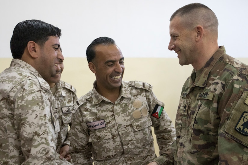 U.S. Army Master Sgt. Michael Komorowski, the senior operations sergeant of the 157th Military Engagement Team, Wisconsin Army National Guard, shares a laugh with soldiers of the Jordan Armed Forces, Dec. 17, 2018, at the Jordanian noncommissioned officer academy near the Joint Training Center, Jordan. Soldiers from the U.S. Army and JAF shared their knowledge on classroom instruction through a small group discussion.
