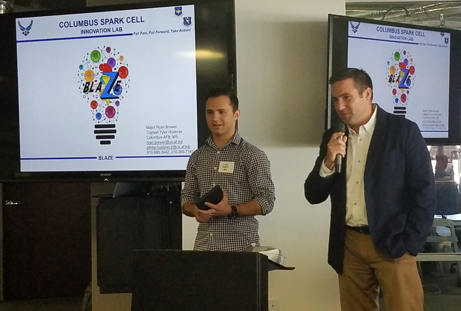 Maj. Ryan Brewer (right), 14th Flying Training Wing Spark Cell director, explains how the Columbus Air Force Base, Mississippi, Spark Cell is creating a culture of innovation at the AFWERX Spark Cell Workshop Dec. 13, 2018, in Austin, Texas. The workshop was designed to help grow the network of willing collaborators and share ideas and approaches that foster a results-driven culture of innovation.
