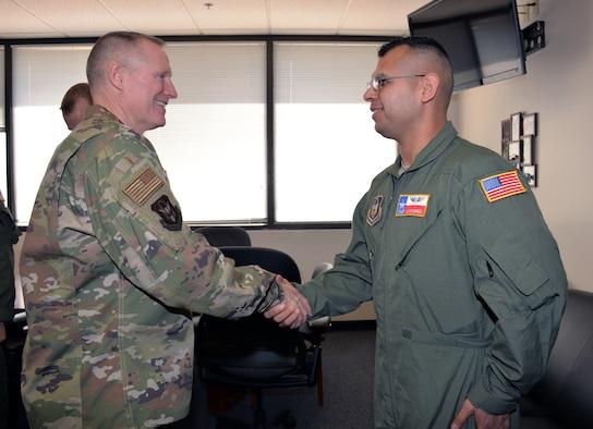 Maj. Gen. Kenneth D. Lewis Jr., Air Force Reserve Command deputy commander, presents a coin to Tech. Sgt. Edgar Ramirez, 433rd Aeromedical Evacuation Squadron, Jan. 3, 2018 at Joint Base San Antonio-Lackland, Texas