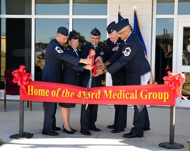 The 433rd Airlift Wing and 433rd Medical Group leaders cut a ribbon to signify opening the medical group's new building Jan. 4, 2018 at Joint Base San Antonio-Lackland, Texas.