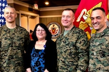 Col. William Bentley (left), the commanding officer of Marine Corps Base Quantico, Elaine Marsh, Brig. Gen. David Maxwell, the assistant deputy commandant for Installations and Logistics, and Col. Joseph Murray, the commander of Marine Corps Installations National Capital Region, pose for a photo during Elaine's retirement at Lejeune Hall aboard MCB Quantico, Virginia, January 3, 2019. Elaine served as a federal employee for 31 years and 11 months.
