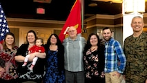 Col. William Bentley, the commanding officer of Marine Corps Base Quantico, Elaine Marsh, and her family pose for a photo during Elaine's retirement at Lejeune Hall aboard MCB Quantico, Virginia, January 3, 2019. Elaine served as a federal employee for 31 years and 11 months.