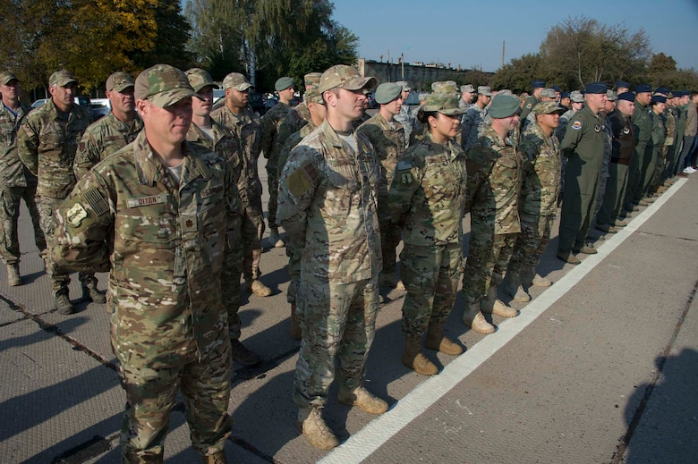 A formation of Americans, Estonians, Swiss, and Ukrainian military stand at the opening ceremony of exercise Clear Sky 2018 Oct. 8, 2018 at Vinnytisa Air Base, Ukraine. Clear Sky was a multi-national exercise aimed to promote peace, security and interoperability between regional allies as well as NATO partners. The two-week exercise brought together nearly 1,000 military personnel from nine countries. (U.S. Air National Guard photo by Master Sgt. Joseph Prouse)