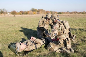 Danish pararescuemen secure Staff Sgt. Mikhail Scheglov, a finance technician with the 141st Comptroller Flight, to a stretcher during a training exercise during Clear Sky 2018 Oct. 16, 2018 at Vinnytsia Air Base, Ukraine. Clear Sky was a multi-national exercise aimed to promote peace, security and interoperability between regional allies as well as NATO partners. The two-week exercise brought together nearly 1,000 military personnel from nine countries. (U.S. Air National Guard photo by Staff Sgt. Brian Jarvis)