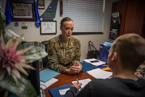 Air Force Reserve recruiter helps with last enlistment in 2018 for the  932nd Airlift Wing.