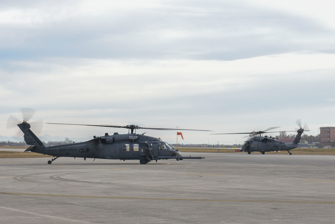Two HH-60G Pave Hawk helicopters assigned to the 56th Rescue Squadron prepare to takeoff at Aviano Air Base, Italy, Dec. 17, 2018. The 56th Rescue Squadron provides a rapidly-deployable, worldwide combat rescue and reaction force response utilizing HH-60G Pave Hawk helicopters.