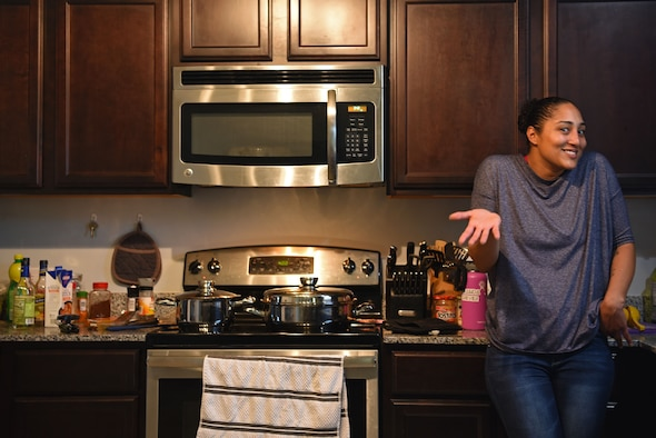U.S. Air Force Tech. Sgt. Ashley Grugin, 20th Aircraft Maintenance Squadron unit fitness program manager, discusses her passion for cooking at her residence in Sumter, S.C., Dec. 16, 2018.