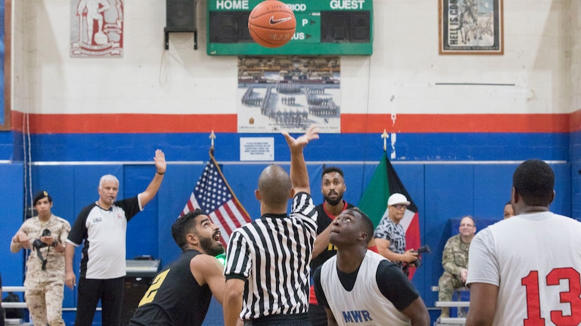 U.S. Army Soldiers with Area Support Group - Kuwait basketball team and Kuwaiti soldiers assigned to the 94th Mechanized Infantry Brigade start the first game of the 2018 Kuwaiti-US basketball tournament at Camp Arifjan, Kuwait, Oct. 26, 2018. Participating in these kind of events demonstrates our enduring commitment to our host nation partnership and develops good Soldier morale.