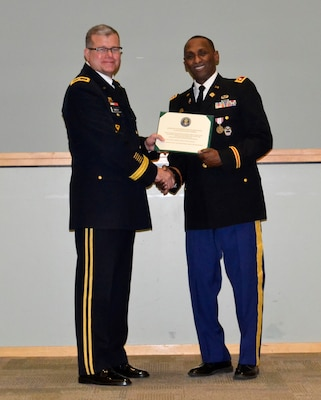 Army Lt. Col. Thomas E. Wooden Jr., right, receives his retirement certificate from DLA Troop Support Commander Army Brig. Gen. Mark T. Simerly during a retirement ceremony in Philadelphia Jan. 4, 2018.