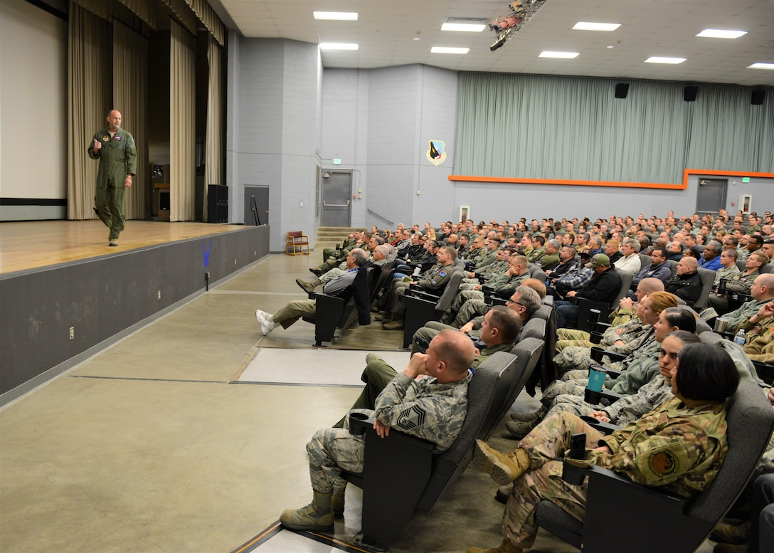 Brig. Gen. E. John Teichert, 412th Test Wing commander, addresses a packed base theater Jan. 2 for the wing's annual Back in the Saddle event. (U.S. Air Force photo by Kenji Thuloweit)