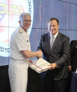 Panamanian President Juan Carlos Varela exchanges gifts with Navy Adm. Craig Faller, Commander of U.S. Southern Command.