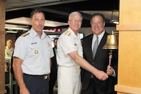 Panamanian President Juan Carlos Varela rings the JIATF South joint operations center (JOC) floor bell alongside Navy Adm. Craig Faller, Commander of U.S. Southern Command, and Coast Guard Rear Adm. Pat DeQuattro, JIATF South Director.