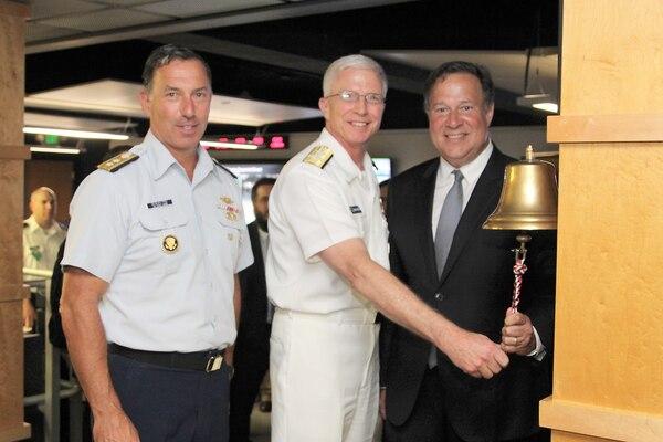 Panamanian President Juan Carlos Varela rings the JIATF South joint operations center (JOC) floor bell alongside Navy Adm. Craig Faller, Commander of U.S. Southern Command, and Coast Guard Rear Adm. Pat DeQuattro, JIATF South Director.