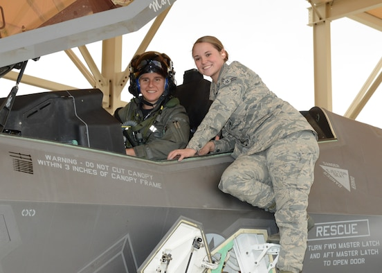 Maj. Rachael Winiecki, 461st Flight Test Squadron F-35 test pilot (left), and Airman 1st Class Heather Rice, 412th Aircraft Maintenance Squadron crew chief, pose for a photo right after Winiecki landed her F-35 Lightning II on her first test mission flight in the fifth-generation fighter Dec. 14, 2018. (U.S. Air Force photo by Kenji Thuloweit)