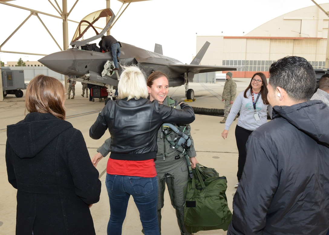 Maj. Rachael Winiecki, 461st Flight Test Squadron F-35 test pilot, is greeted by members of her squadron right after she landed her F-35 Lightning II following her first test mission flight in the fifth-generation fighter Dec. 14, 2018. (U.S. Air Force photo by Kenji Thuloweit)