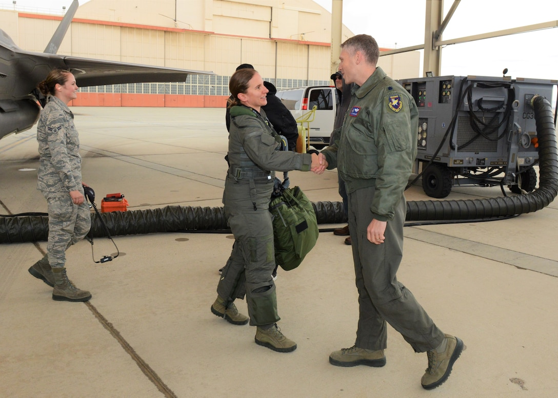 Maj. Rachael Winiecki, 461st Flight Test Squadron F-35 test pilot, is congratulated by Lt. Col. Tucker Hamilton, 461st FLTS commander, after she landed her F-35 Lightning II following her first test mission flight in the fifth-generation fighter Dec. 14, 2018. (U.S. Air Force photo by Kenji Thuloweit)